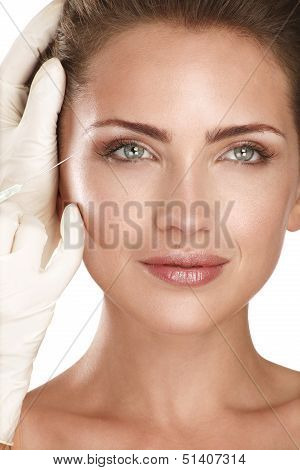 Young Beautiful Model Injecting  A Cosmetic Treatment