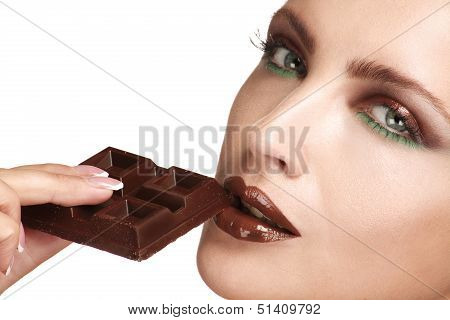 Close Up Of A Beautiful Model Tasting Dark Chocolate