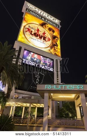 The Mirage Hotel Sign Featuring The Beatles Love Show In Las Vegas, Nv On August 29, 2013