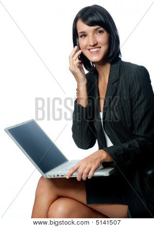 Businesswoman With Laptop And Phone