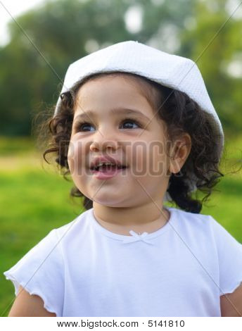 Two Year Old Girl In A White Hat