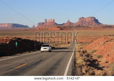 Usa, Monument Valley- Road Leading Up To Valley With Car