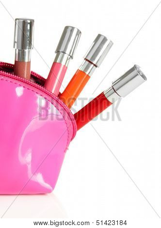Beautiful make up bag with lip glosses, isolated on white
