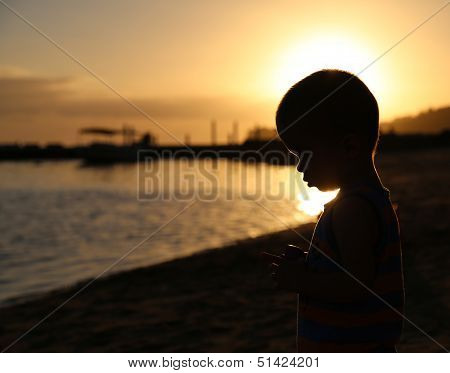Little Boy Silhouette At The Beach