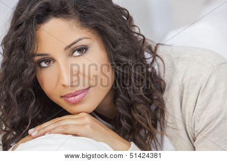 Studio portrait of a beautiful young mixed race Latina Hispanic woman smiling