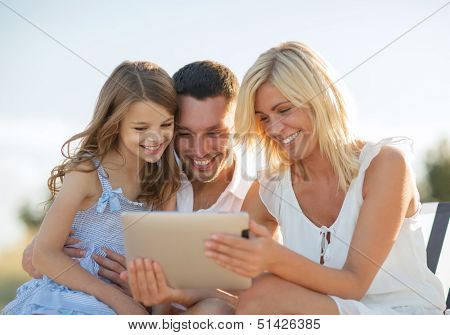 summer holidays, children and people concept - happy family with tablet pc taking picture