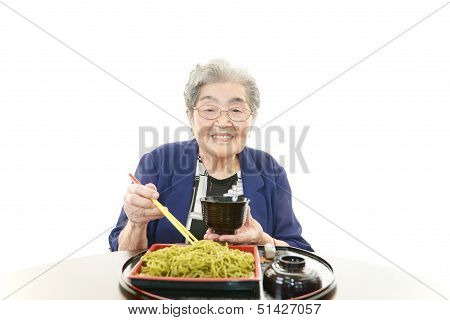Old woman eating food
