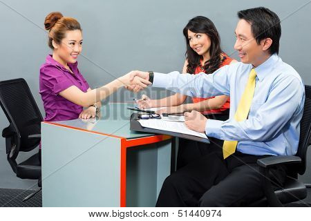 Job interview with an Asian candidate for an new office employment or negotiation for hiring