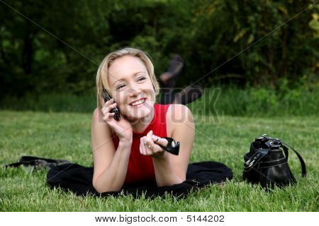 Woman Talks On A Mobile Phone