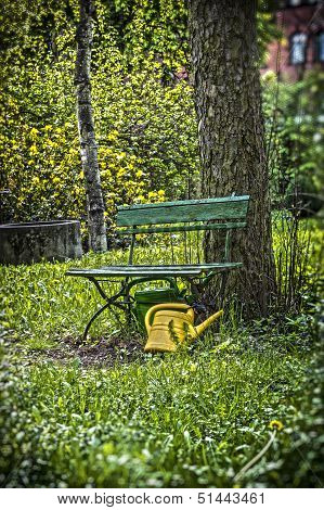 Garden Bench With Yellow Ewer