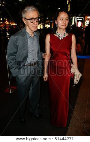NEW YORK-SEP 24: Woody Allen and Soon Yi Previn attend HUGO BOSS celebrates Columbus Circle BOSS flagship opening on September 24, 2013 in New York City.