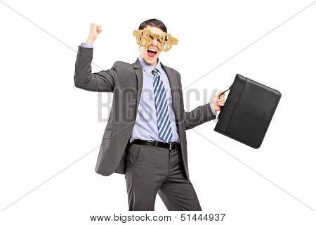 Euphoric businessman wearing dollar sign glasses and holding a leather suitcase isolated on white background