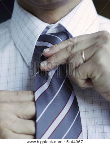 Business Man Adjusting His Tie