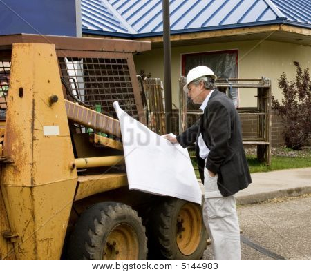 Architect Builder Reading Blueprints
