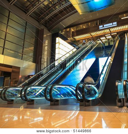 Moving Escalators In Lobby At Night