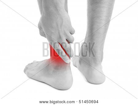 Young man with leg pain, isolated on white