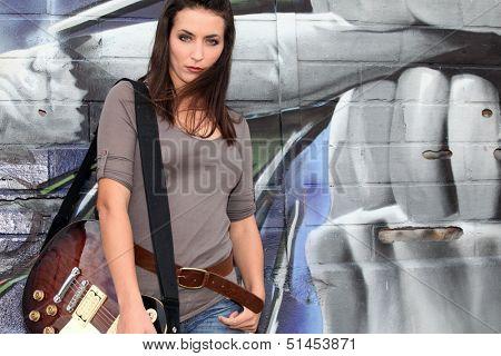 Trendy female guitarist