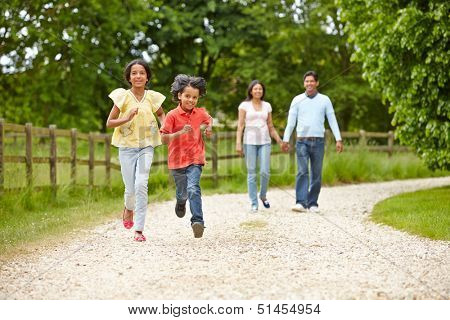 Indian Family Walking In Countryside