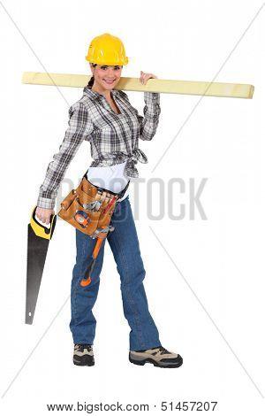 Female carpenter carrying  wood