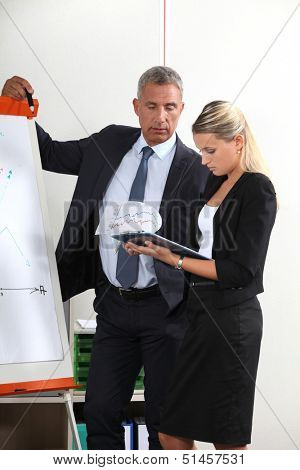 A team of business professionals reviewing their data before a presentation