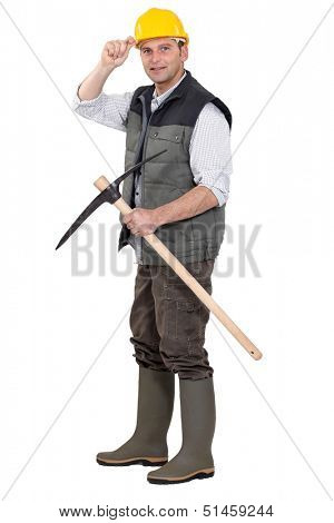 Workman with pickaxe on white background