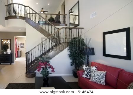 Stair Case In High Ceiling Home