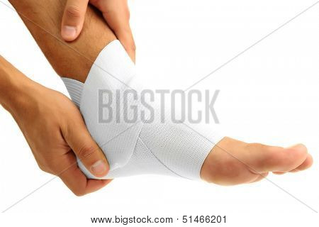 Young man with elastic bandage on leg, isolated on white