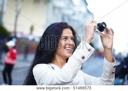 Nice woman making photo