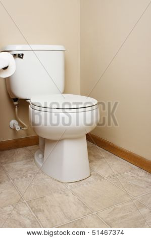 Generic white toilet in bathroom