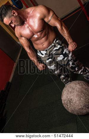 Bodybuilder Resting After Picking Up A Stone