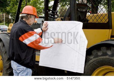 Engineer Reading Blueprints