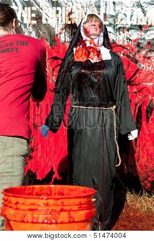Woman Wearing Nun Costume Gets Fake Blood Splattered On Habit