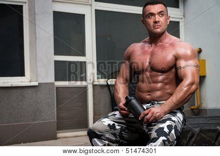 Bodybuilder With Protein Shake