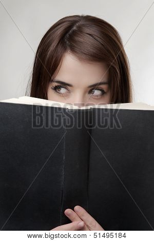Peering Over Book