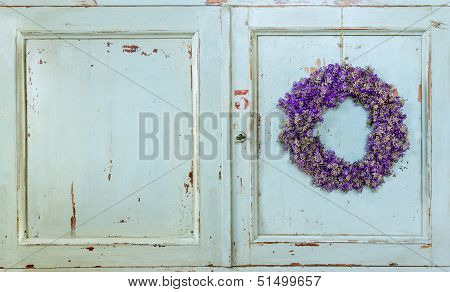Lavender Flower Wreath Hanging On An Old Door