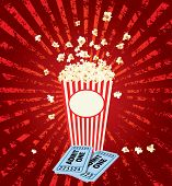 stock photo of popcorn  - popcorn explosion with admit one tickets - JPG
