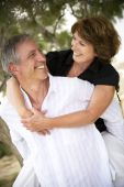 picture of loving_couple  - Beautiful mature couple having fun and smiling - JPG