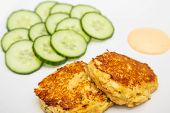 pic of crab-cakes  - Fresh crab cakes on a white plate with sauce - JPG