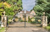 picture of exclusive  - wrought iron gate in front of exclusive home