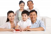 stock photo of east-indian  - A shot of Whole family and sit on white - JPG