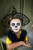 image of antichrist  - Portrait of cute girl in Halloween costume looking at camera with frightening expression - JPG