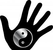 stock photo of ying-yang  - Ying and Yang symbol with a hand silhouette - JPG