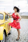 Woman In Dress Rely Leg On Car poster