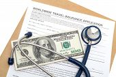 image of reimbursement  - Worldwide travel medical insurance application with stethoscope on money - JPG