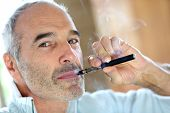 picture of smoker  - Portrait of senior smoker with electronic cigarette - JPG
