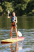 stock photo of paddling  - Woman riding stand - JPG