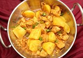 stock photo of kadai  - A vindaloo chicken and potato curry - JPG
