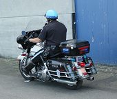 SFPD police officer riding motorcycle at patrol in San Francisco Bay area