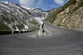 stock photo of italian alps  - Serpentine road in the italian Alps leads to Stelvio Pass