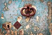 picture of grotesque  - Antique portal with beautiful ornate door knocker and old keyhole landscape detail - JPG